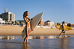 A female surfer looks out to the morning waves at Bondi Beach.  Sydney, New South Wales, AUSTRALIA.