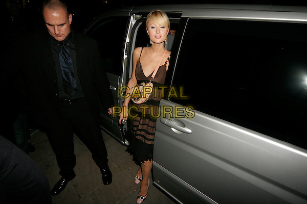 "PARIS HILTON.""Casanova"" UK premiere aftersow party, London, UK..February 13th, 2006.Ref: SW.full length brown dress car gold purse bag.www.capitalpictures.com.sales@capitalpictures.com.©Capital Pictures."