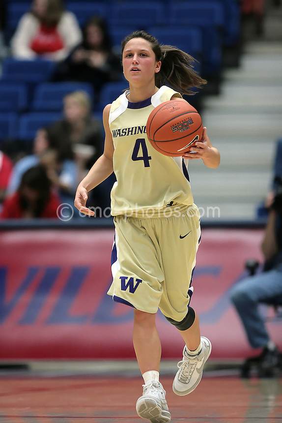 Feb 21, 2008; Tucson, AZ, USA; Washington Huskies guard Emily Florence dribbles the ball up court during a game against the Arizona Wildcats.  The Huskies would win the game at the McKale Center 60-58.  Florence had 5 points, 5 rebounds, 3 assists and 1 steal during 40 minutes of action.