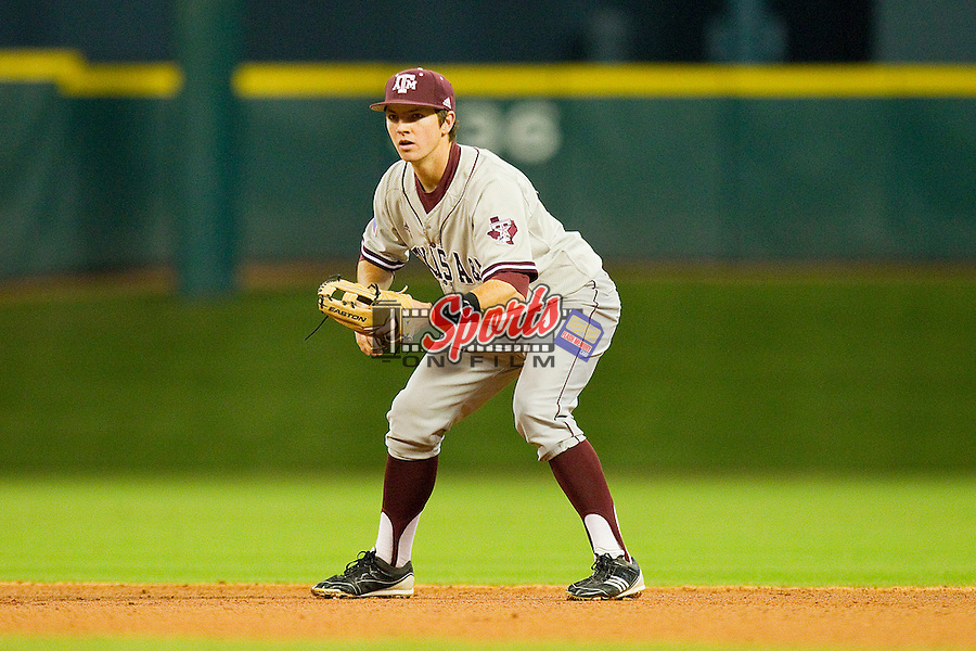 Second baseman Charlie Curl #4 of the Texas A&M Aggies on defense against the Houston Cougars at Minute Maid Park on March 6, 2011 in Houston, Texas.  Photo by Brian Westerholt / Four Seam Images