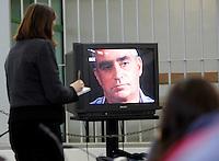 Giornalisti assistono alla proiezione di un'intervista a Claudio Cesaroni, padre di Simonetta, durante l'udienza per il delitto della figlia, presso l'aula bunker di Rebibbia, Roma, 16 febbraio 2010..UPDATE IMAGES PRESS/Riccardo De Luca