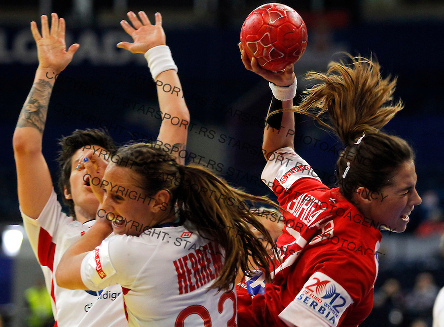 BELGRADE, SERBIA - DECEMBER 13:  Louise Burgaard (R) of Denmark is challenged by Camilla Herrem (L) of Norway during the Women's European Handball Championship 2012 Group I main round match between Norway and Denmark at Arena Hall on December 13, 2012 in Belgrade, Serbia. (Photo by Srdjan Stevanovic/Getty Images)