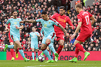 Burnley's Andre Gray under pressure from Liverpool's Emre Can<br /> <br /> Photographer Rich Linley/CameraSport<br /> <br /> The Premier League - Liverpool v Burnley - Sunday 12 March 2017 - Anfield - Liverpool<br /> <br /> World Copyright &copy; 2017 CameraSport. All rights reserved. 43 Linden Ave. Countesthorpe. Leicester. England. LE8 5PG - Tel: +44 (0) 116 277 4147 - admin@camerasport.com - www.camerasport.com