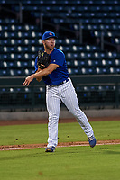 AZL Cubs 1 relief pitcher Brandon Hughes (25) throws to first base during an Arizona League game against the AZL Athletics Gold at Sloan Park on June 20, 2019 in Mesa, Arizona. AZL Athletics Gold defeated AZL Cubs 1 21-3. (Zachary Lucy/Four Seam Images)