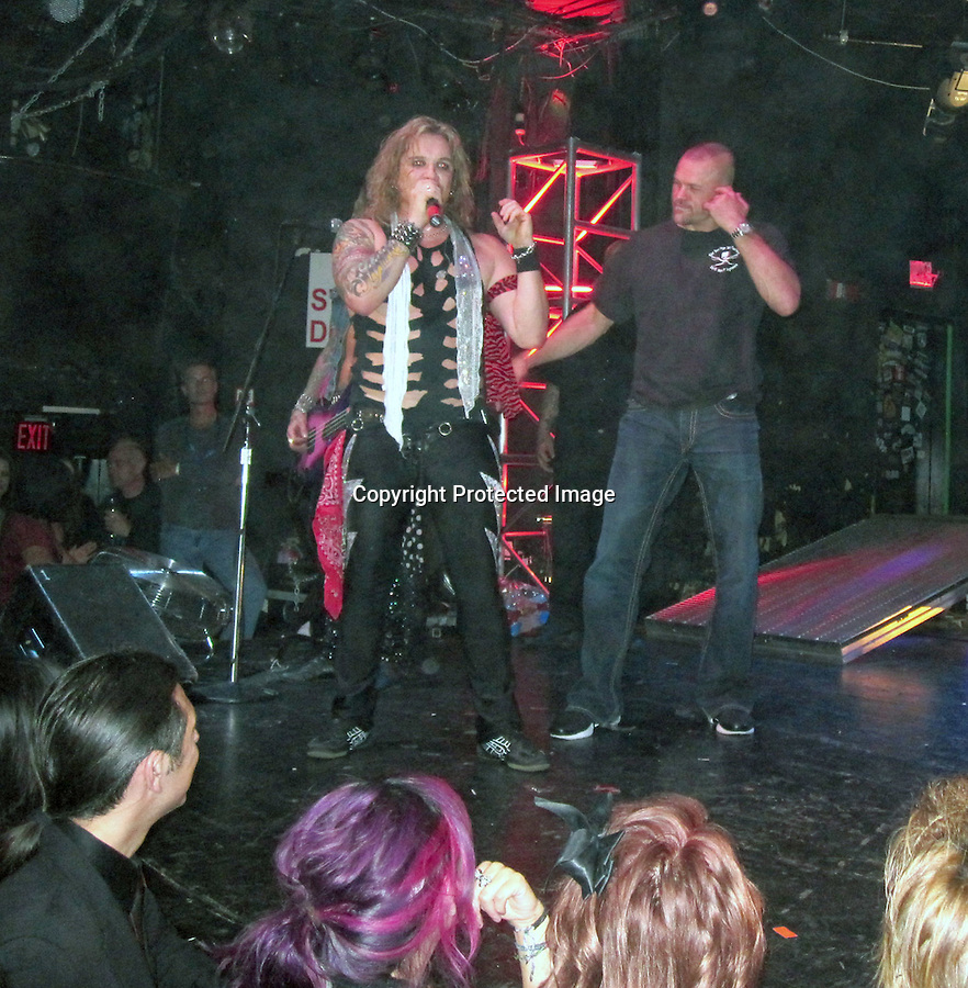 """10-19-09  Exclusive..Xtreme cage fighter and now a dancer Chuck Liddell & Christopher Mintz Plasse from the movie SuperBad singing on stage at a Steel Panther show at the Key Club in Hollywood California. Chuck didn't  know the words to the song & seemed very awkward on stage while Signing the song """"Death to all rock metal"""" but Christopher seemed right at home he even chanted """"Show your boobs"""" to a porn star in the audience named Bridgette B. Then Christopher A.K.A McLovin also sang  """"small town girl"""" by Journey .....AbilityFilms@yahoo.com.805-427-3519.www.AbilityFilms.com"""