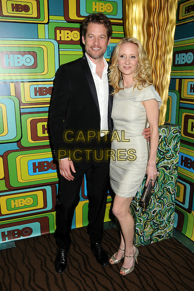 JAMES TUPPER & ANNE HECHE.HBO 2011 Post Golden Globe Awards Party held at The Beverly Hilton Hotel, Beverly Hills, California, USA..January 16th, 2011.full length beige dress one sleeve  couple silver clutch bag .CAP/ADM/BP.©Byron Purvis/AdMedia/Capital Pictures.