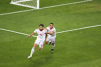 SARANSK, RUSSIA - June 25, 2018: Karim Ansarifard (10) is congratulated by teammate Milad Mohammadi (5) after scoring a penalty in their 2018 FIFA World Cup group stage match against Portugal at Mordovia Arena.