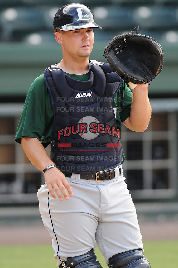 Catcher Ryan McCurdy (9) of the Lexington Legends, a Houston Astros affiliate, before a game against the Greenville Drive on July 19, 2012, at Fluor Field at the West End in Greenville, South Carolina. (Tom Priddy/Four Seam Images)