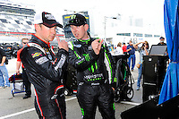 Kurt Busch (#1-L) listens to little brother Kyle Busch (#54).