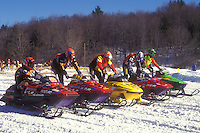 snowmobiling, winter, Waitsfield, VT, Vermont, Drivers lined up with their snowmobiles starting their engines to begin the Snowmobile Race at the Mad River Valley Winter Carnival in Waitsfield in winter.
