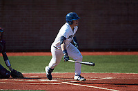 McCann Mellett (9) of the Wingate Bulldogs follows through on his swing against the Concord Mountain Lions at Ron Christopher Stadium on February 2, 2020 in Wingate, North Carolina. The Mountain Lions defeated the Bulldogs 12-11. (Brian Westerholt/Four Seam Images)