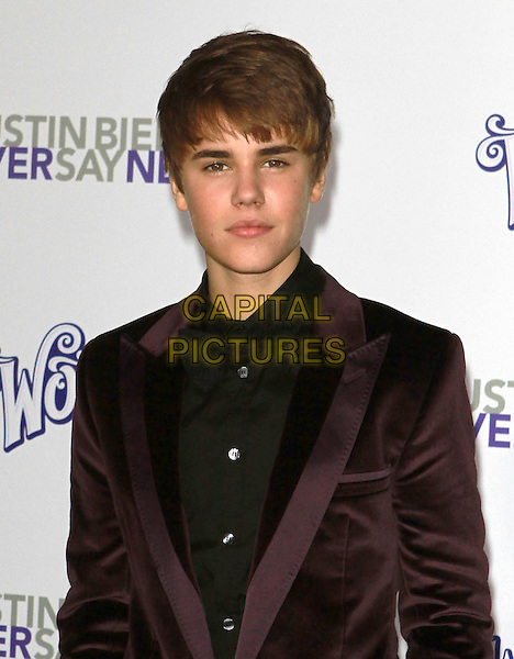 """JUSTIN BIEBER .Attending """"Justin Bieber: Never Say Never"""" Los Angeles Premiere held At Nokia Theatre L.A Live, Los Angeles, California, USA, .8th February 2011..half length brown velvet jacket purple black shirt .CAP/ADM/KB.©Kevan Brooks/AdMedia/Capital Pictures."""