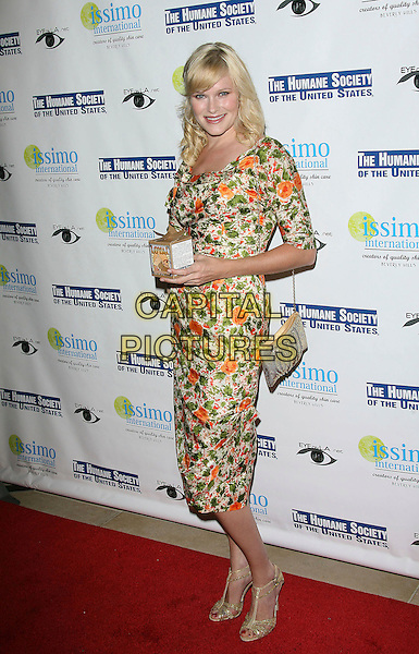 NICHOLLE TOM.Issimo International Introduces Loyal for The Humane Society of The United States held at the Sunset Tower Hotel - Arrivals, West Hollywood, California, USA, .27 September 2006..full length.Ref: ADM/ZL.www.capitalpictures.com.sales@capitalpictures.com.©Zach Lipp/AdMedia/Capital Pictures.