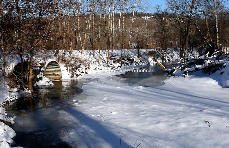 Southbury, CT- 06 February 2015-020615CM01-   Water flows out of culverts from the Transylvania Brook into the Pomperaug River in Southbury on Friday.  The town has received a more than $1 million grant from the feds to rebuild a bridge on East Flat Hill Road by the Audubon Center at Bent of the River.   Christopher Massa Republican-American