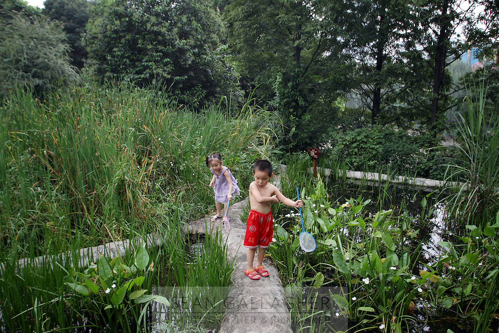 """Children play in the """"Living Water Garden"""" in Chengdu, Sichuan Province. The garden is a park aimed at highlighting the importance of the relationship between man and water. 2010"""