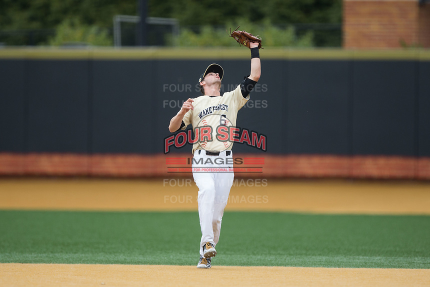 Wake Forest Demon Deacons second baseman Jake Mueller (6) catches a fly ball during the game against the Georgia Tech Yellow Jackets at David F. Couch Ballpark on March 26, 2017 in  Winston-Salem, North Carolina.  The Demon Deacons defeated the Yellow Jackets 8-4.  (Brian Westerholt/Four Seam Images)