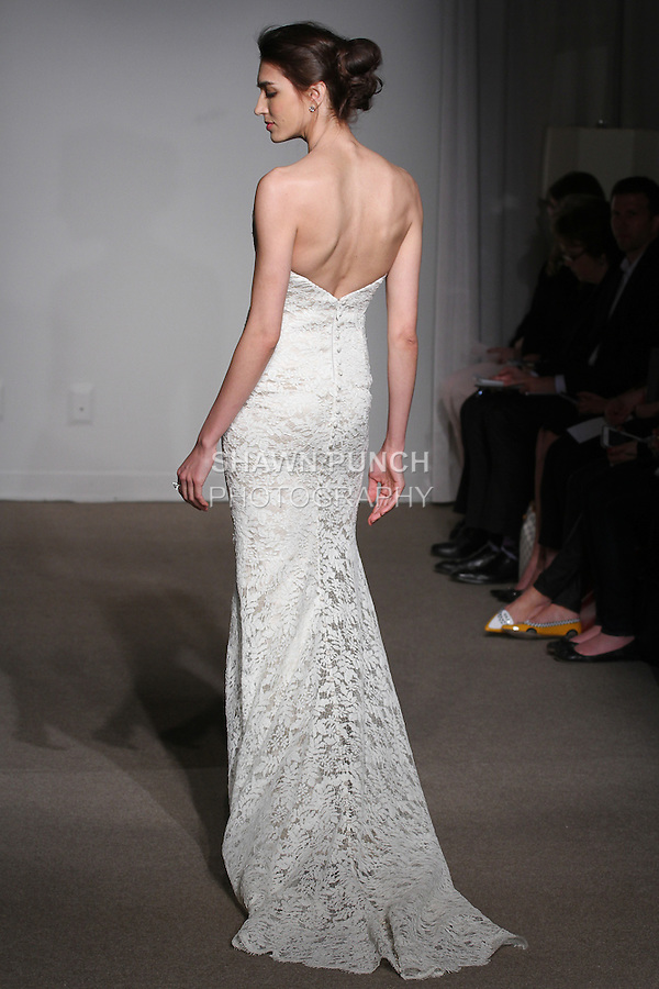 """Model walks runway in an Alex bridal gown from the Anna Maier Couture Spring 2016 """"Collection 43"""" during New York Bridal Fashion Week Spring 2016."""