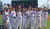Clemson players stand for the alma mater at the end of a game between the Clemson Tigers and USC Gamecocks on March 2, 2008, at Doug Kingsmore Stadium in Clemson, S.C. The Gamecocks won 5-1.   Photo by: Tom Priddy/Four Seam Images