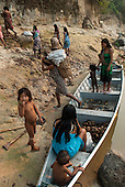 Aldeia Baú, Para State, Brazil. Group of women and children in a boat on a babassu collecting trip.