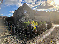 BNPS.co.uk (01202 558833)<br /> Pic: SandyPotter/BNPS<br /> <br /> PICTURED: Sandy Potter at the Watermill<br /> <br /> A mother who became a property developer to support her daughters after a divorce has unveiled her latest stunning holiday let - a stunning converted 15th century water mill.<br /> <br /> Sandy Potter, 53, has transformed The Water Mill, in Derbys, into a 16 person detached holiday home nestled in the heart of the idyllic Peak District countryside.<br /> <br /> The Grade II listed property features in the Domesday Records and was used to mill corn and wheat until about 1960.<br /> <br /> She has restored its 300 year old water wheel, and the seven bedroom holiday home retains its ancient stonework and oak beams.<br /> <br /> More modern touches include a luxurious Champagne bar and a hot tub.