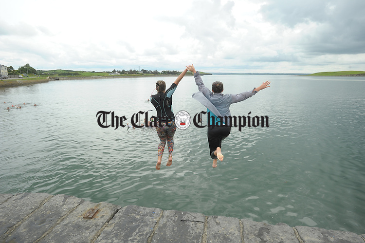 Caoimhe Morrissey and Crioa Crowley take a plunge as part of their lifesaving and Water Safety classes at Cappa, Kilrush, run by the Clare Water Safety Association. Photograph by John Kelly.