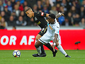 10th September 2017, Liberty Stadium, Swansea, Wales; EPL Premier League football, Swansea versus Newcastle United; Dwight Gayle of Newcastle United and Leroy Fer of Swansea City battle for possession during the match