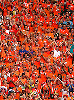 Netherlands fans cheer their side on all wearing orange