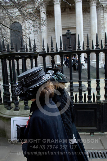 Mourners in black hats pass as others descend the steps leading from the North Portico of St Paul's Cathedral following the funeral of Margaret Thatcher. <br />