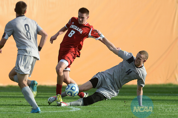 09 DEC 2012:  Cole Seiler (14) of Georgetown University looks for a slide tackle against Nikita Kotlov (8) of Indiana University during the Division I Men's Soccer Championship held at the Regions Park in Hoover, AL.  Indiana defeated Georgetown to win the national title. Peter Lockley/NCAA Photos