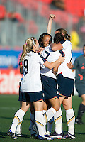 USA team celebrates Shannon Boxx's (7) goal. The US Women's National Team defeated the Canadian Women's National Team, 4-0, at BMO Field in Toronto during an international friendly soccer match on May 25, 2009.