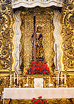 Nuestro Padre Jesus Nazareno figure on an altar in the church of San Antonio Abad, Seville, Spain