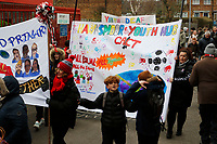 Banners arrive at the Valley as part of the Red, White & Black day procession in support of Charlton Athletic Race & Equality Partnership (CARE) during the Sky Bet League 1 match between Charlton Athletic and Fleetwood Town at The Valley, London, England on 17 March 2018. Photo by Carlton Myrie.