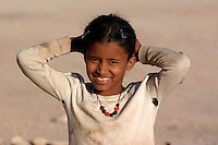 A child is pictured in the wilaya of Ausserd on December 14, 2003.Saharawi people have been living at the refugee camps of the Algerian desert named Hamada, or desert of the deserts, for more than 30 years now. Saharawi people have suffered the consecuences of European colonialism and the war against occupation by Moroccan forces. Polisario and Moroccan Army are in conflict since 1975 when Hassan II, Moroccan King in 1975, sent more than 250.000 civilians and soldiers to colonize the Western Sahara when Spain left the country. Since 1991 they are in a peace process without any outcome so far. (Ander Gillenea / Bostok Photo)