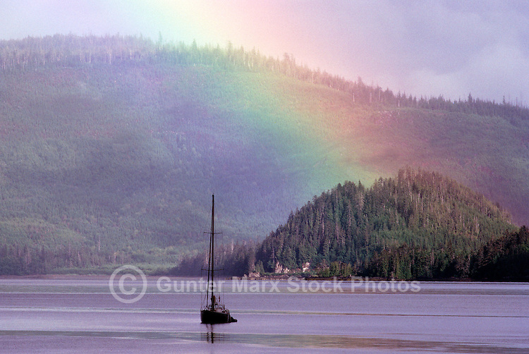 Haida Gwaii (Queen Charlotte Islands), Northern BC, British Columbia, Canada - Rainbow over Sailboat sailing in Skidegate Inlet, near Graham Island