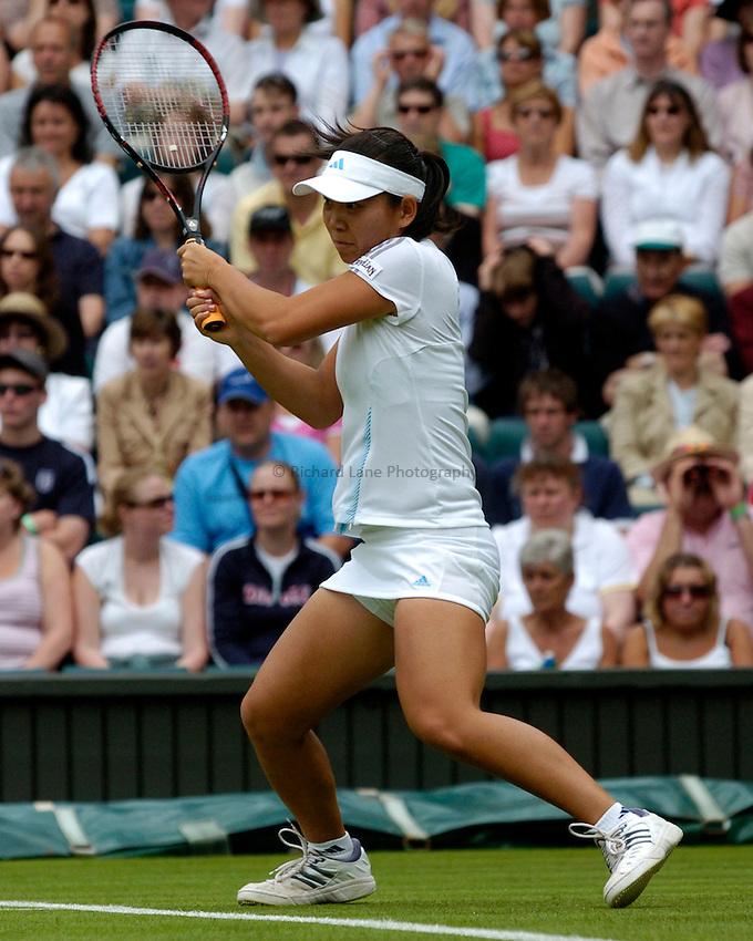 Photo: Richard Lane..Wimbledon Championships. 27/06/2006. .Meng Yuan of China returns.