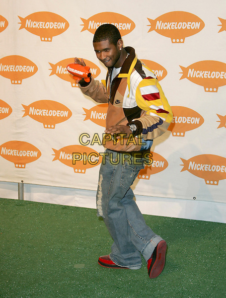 USHER.Nickelodeon's 18th Annual Kids' Choice Award Show held at UCLA's Pauley Pavilion in Westwood, California .April 2nd, 2005.full length brown patched leather jacket nike jeans denim dancing .www.capitalpictures.com.sales@capitalpictures.com.Supplied By Capital PIctures