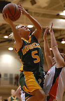 Howell senior Kerri Yarber, left, shoots over Brighton junior Genevieve Sixbey-Spring during the first quarter at Brighton High School on Thursday, October 5, 2006. Brighton coach Jason Piepho led the team to victory over Howell, which is coached by his father, Lee Piepho.