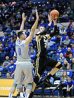 December 12, 2015 - Colorado Springs, Colorado, U.S. -  Army center, Kevin Ferguson #31, drives for the basket during an NCAA basketball game between the Army West Point Black Knights and the Air Force Academy Falcons at Clune Arena, U.S. Air Force Academy, Colorado Springs, Colorado.  Army West Point defeats Air Force 90-80.
