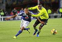 BOGOTA -COLOMBIA- 13 -11--2013. Lewis Ochoa (Izq)  de Millonarios  disputa el balon contra Juan Valencia (Der) del Atletico Nacional , encuentro de ida por la final de la Copa Postobon jugado en el estadio Nemesio Camacho El Campin   / Lewis Ochoa  (L) of Millonarios dispute the ball against Juan Valencia  (R) of Atletico Nacional, first leg by Postobón Cup final played at the Estadio Nemesio Camacho El Campin .Photo: VizzorImage / Felipe Caicedol / Staff