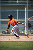 Baltimore Orioles Gerrion Grim (98) follows through on a swing during a minor league Spring Training game against the Minnesota Twins on March 17, 2017 at the Buck O'Neil Baseball Complex in Sarasota, Florida.  (Mike Janes/Four Seam Images)