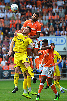 Blackpool's Curtis Tilt competes in the air with Fleetwood Town's Ashley Eastham<br /> <br /> Photographer Richard Martin-Roberts/CameraSport<br /> <br /> The EFL Sky Bet League One - Blackpool v Fleetwood Town - Monday 22nd April 2019 - Bloomfield Road - Blackpool<br /> <br /> World Copyright © 2019 CameraSport. All rights reserved. 43 Linden Ave. Countesthorpe. Leicester. England. LE8 5PG - Tel: +44 (0) 116 277 4147 - admin@camerasport.com - www.camerasport.com