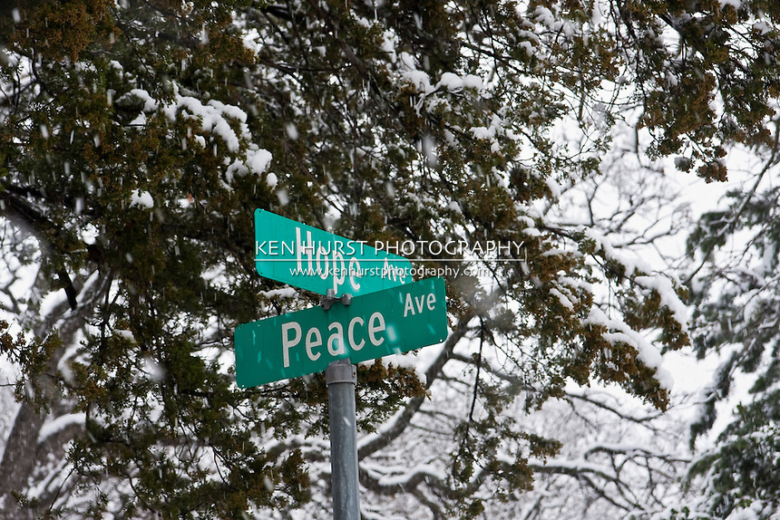 Street signs (Hope and Peace) in Greenwood Cemetery in Dallas, Texas during a rare winter snowfall in February 2010.