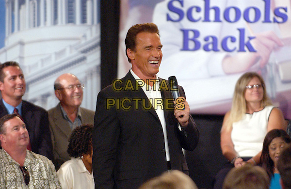 ARNOLD SCHWARZENEGGER - ARNIE.at his 'AskArnold' Town Hall Meeting during his campaign for Governor of California held at Memorial Hall at Chapman College.   .www.capitalpictures.com.sales@capitalpictures.com.©Capital Pictures.campaign trail, politics.