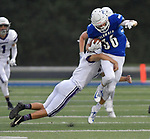 Mascoutah's Logen Timmon (left) tackles Columbia's Ronnie Hunsaker. Columbia played Mascoutah on Saturday August 31, 2019 in a football game that was never started on Friday night due to bad storms.<br /> Tim Vizer/Special to STLhighschoolsports.com