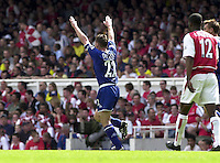 Photo. © Peter Spurrier/Intersport Images.15/05/2004  - 2003/04 Premiership Football - Arsenal v Leicester City:.Paul Dickov raises his arme to the crowd after scoring his goal.[Credit] Peter Spurrier Intersport Images
