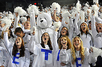 25 October 2014:  Female Penn State fans in the student section cheer and wave pom poms along with a white bear during the whole Beaver Stadium white out. The Ohio State Buckeyes defeated the Penn State Nittany Lions 31-24 in 2 OTs at Beaver Stadium in State College, PA.