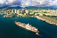 A container ship approaches Honolulu harbor with goods that support our economy. Honolulu, Hawaii