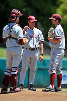 02 June 2008:  Stanford Cardinal Jason Castro (15) and Erik Davis (19) talk over a situation with assistant coach Jeff Austin (8) during Stanford's 9-7 win over the Pepperdine Waves in the NCAA Stanford Regional final game at Klein Field at Sunken Diamond in Stanford, CA.