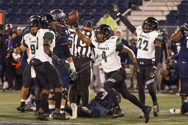 Hawaii defensive back Rojesterman Farris II (4) reacts after recovering a fumble against Nevada in the second half of an NCAA college football game in Reno, Nev. Saturday, Sept. 28, 2019. (AP Photo/Tom R. Smedes)