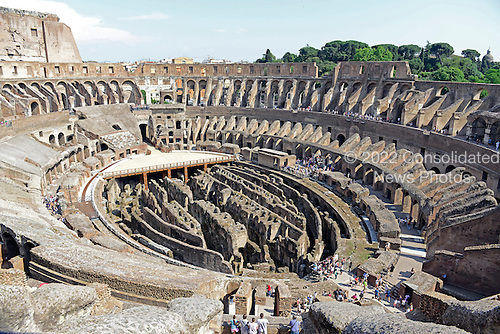 Wide view of the interior from the upper walkway of the Colosseum, also known as the Flavian Amphitheatre, in Rome, Italy on Friday, May 25, 2012.  The partially restored floor, which is used as a stage, is at center left. The hypogeum, an underground network of tunnels and cages containing the holding cells for gladiators or animals, which was located under the wood floor which was covered by sand, is clearly visible..Credit: Ron Sachs / CNP